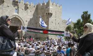 Palestinians protest as Israel takes its Capital