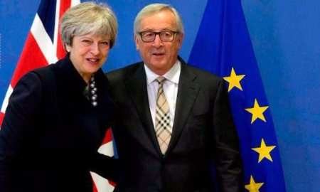 European Commission President Jean-Claude Juncker, right, greets British Prime Minister Theresa May