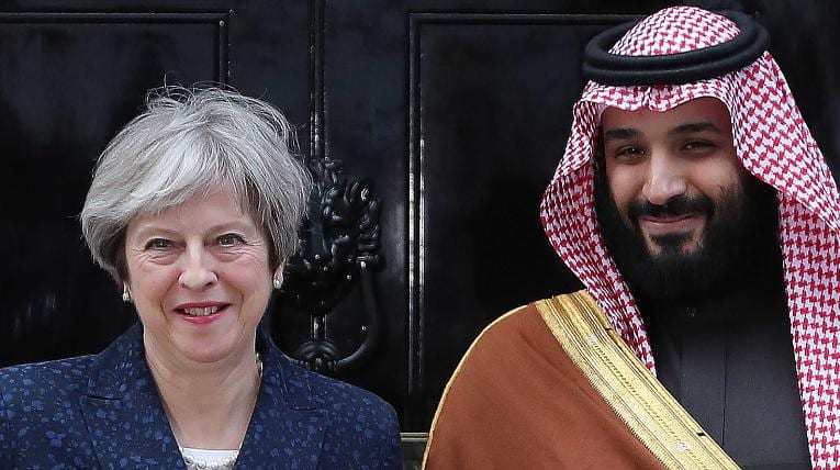 Britain's Prime Minister Theresa May (L) greets Saudi Arabia's Crown Prince Mohammed bin Salman