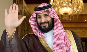 Crown Prince Mohammed bin Salman waves as he meets Jared Kushner and the US led peace envoy in search for middle East Peace