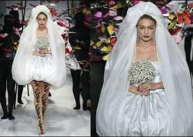 Gigi rocks the wedding dress as she steals the show