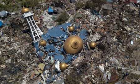 In Palu, rescuers are awaiting heavy machinery as this drone shot shows the destruction of a mosque.