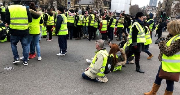 In the UK facing off against police officers guarding the Parliament square, activists called on them to support their cause against corrupt politicians.