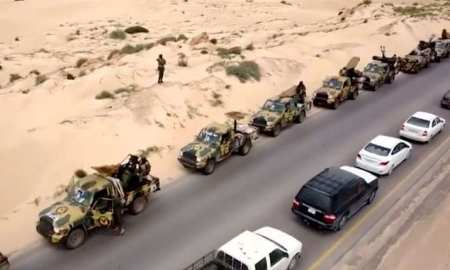 An aerial view shows military vehicles on a road in Libya