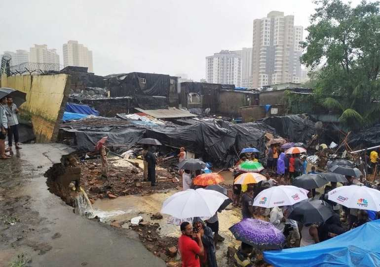 Latest from India: Monsoon rain collapses building, kills 12