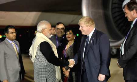 Indian Prime Minister Narendra Modi meets the UK Prime Minister Boris Johnson