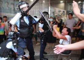 World News Briefing: Hong Kong police accused of abuse - Storm Imelda soaks US & US building anti-Iraq coalition