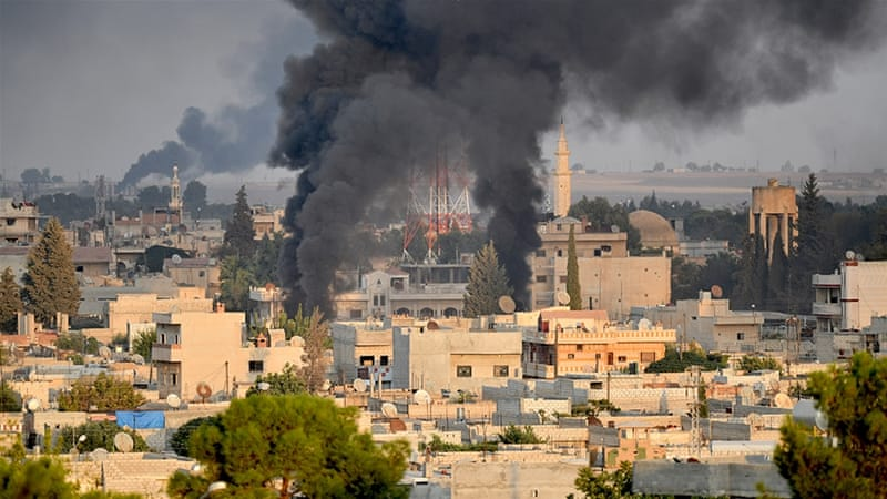 Smoke from destroyed targets rises in the city of Ras al-Ain in Syria after Turkish Air strikes
