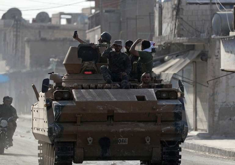 US troops 'leave' Kobani as Turkish incursion advances and Kurds make deal with Damascus