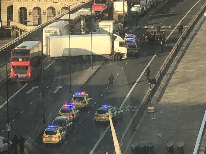 Breaking News: Video at London Bridge Shots fired - A group of men standoff with the Met Police