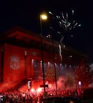 Anfield stadium is hounded by thousands of supporters celebrating Liverpool being crowned champions of England