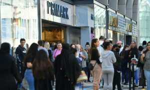 Long queues as shops reopen in England
