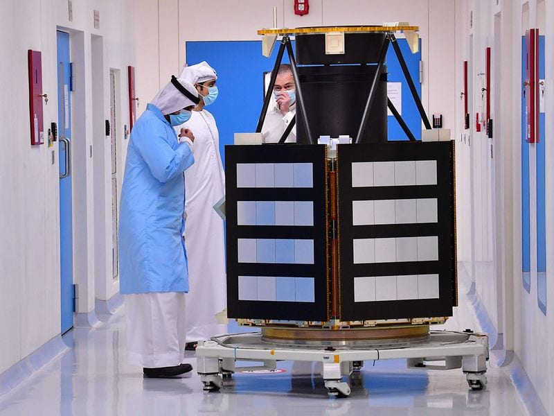 Engineers observe a KhalifaSat model at the Mohammed Bin Rashid Space Centre (MBRSC), in dubai. Only the United States, India, the former Soviet Union, and the European Space Agency have successfully sent missions to orbit the Red Planet, while China is preparing to launch its first Mars rover later this month.