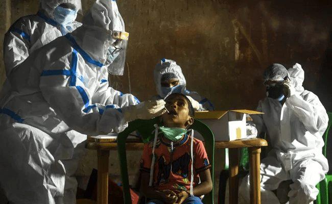India's virus deaths pass Italy's as floods hamper battle