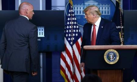 Trump escorted out of White House briefing after shooting on grounds