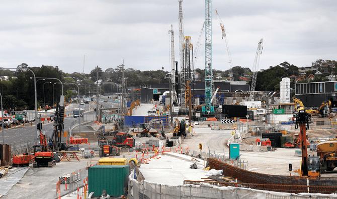 Australia tips into record deficit amid tax cuts and job support