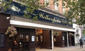 Wetherspoon pubs reveal first loss since 1984
