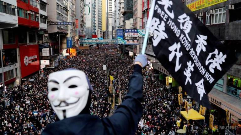 Top Hong Kong court upholds emergency law to ban face masks at protests