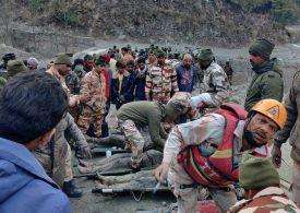 India hit by Himalayan glacier breaks & floods Uttarakhand - 200 still missing - Video