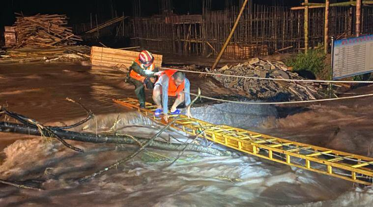 China braces for more bad weather as death toll from flooding mounts