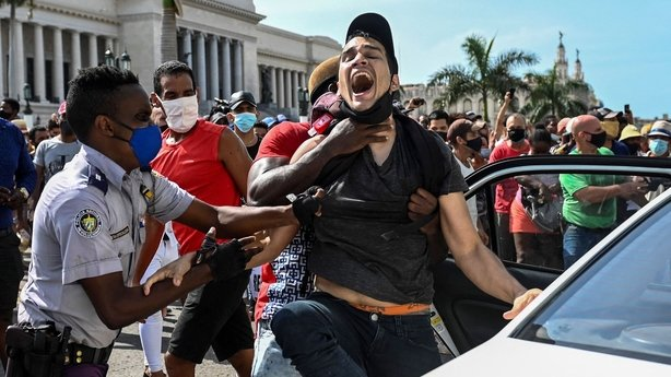One dead, dozens arrested after anti-government protests in Cuba