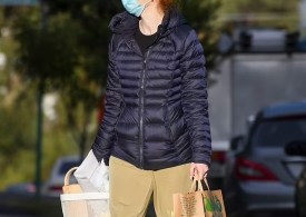 Yellow Wiggle During Sydney's lockdown, Emma Watkins dresses for comfort as she stepsout forsupplies.