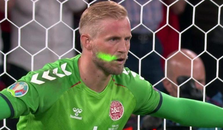 England fans shine laser pen in Kasper Schmeichel's eyes during penalty