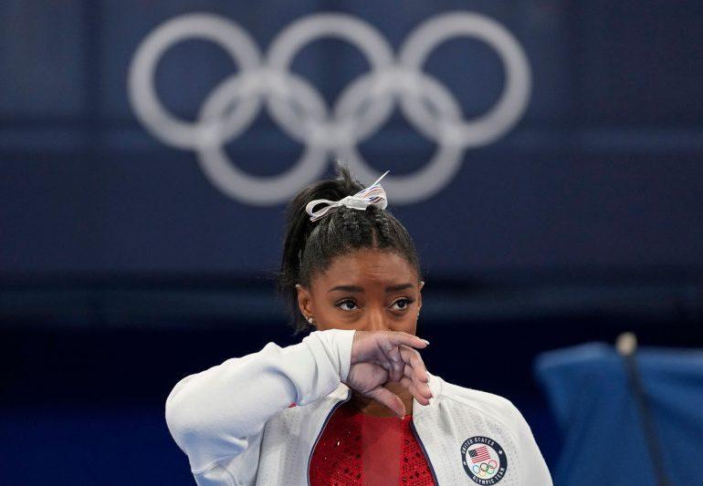 Simone Biles' dramatic exit sparks furious debate on social media as critics claim she 'abandoned' teammates