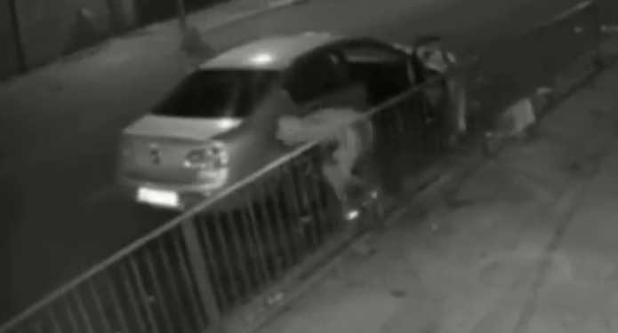 gunman fires six photographs at car leaving two males pouring with blood