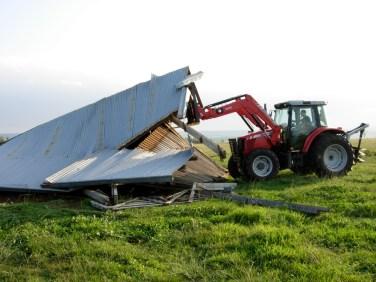 Demolishing the hay barn