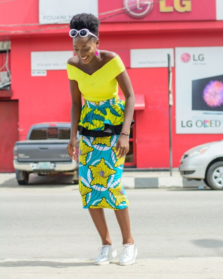 Nigerian Fashion blogger Wumi Tuase in collaborating with SGTC styled yellow colorful african print