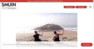Smuin dancers seated at SF beach facing ocean