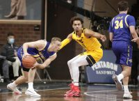 SIOUX FALLS, SD - NOVEMBER 25: Noah Freidel #15 of the South Dakota State Jackrabbits looks past Emmitt Matthews Jr. #11 of the West Virginia Mountaineers during the Bad Boy Mowers Crossover Classic at the Sanford Pentagon in Sioux Falls, SD. (Photo by Richard Carlson/Inertia)