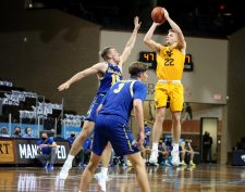 SIOUX FALLS, SD - NOVEMBER 25: Sean McNeil #22 of the West Virginia Mountaineers shoots a jumper over Noah Freidel #15 of the South Dakota State Jackrabbits during the Bad Boy Mowers Crossover Classic at the Sanford Pentagon in Sioux Falls, SD. (Photo by Dave Eggen/Inertia)