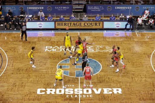 SIOUX FALLS, SD - NOVEMBER 27: West Virginia and Western Kentucky tip off during the Bad Boy Mowers Crossover Classic at the Sanford Pentagon in Sioux Falls, SD. (Photo by Richard Carlson/Inertia)