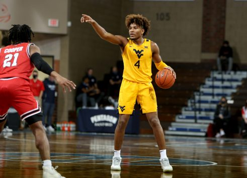SIOUX FALLS, SD - NOVEMBER 27: Miles McBride #4 of the West Virginia Mountaineers calls out a play against Western Kentucky Hilltoppers during the Bad Boy Mowers Crossover Classic at the Sanford Pentagon in Sioux Falls, SD. (Photo by Dave Eggen/Inertia)