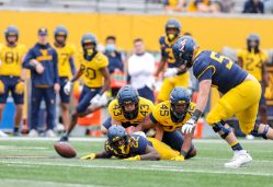April 24, 2021; Morgantown, West Virginia, USA; West Virginia Mountaineers players watch a fumble during the Spring Game at Mountaineer Field at Milan Puskar Stadium. Mandatory Credit: Ben Queen