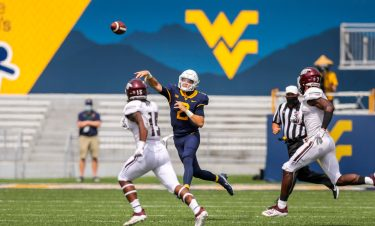 Sep 12, 2020; Morgantown, West Virginia, USA; West Virginia Mountaineers quarterback Jarret Doege (2) throws a pass during the first quarter against the Eastern Kentucky Colonels at Mountaineer Field at Milan Puskar Stadium. Mandatory Credit: Ben Queen-USA TODAY Sports