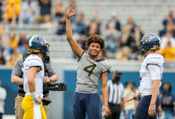 April 24, 2021; Morgantown, West Virginia, USA; West Virginia Mountaineers point guard Miles McBride competes in a throwing competition during the Spring Game at Mountaineer Field at Milan Puskar Stadium. Mandatory Credit: Ben Queen
