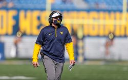 Oct 31, 2020; Morgantown, West Virginia, USA; West Virginia Mountaineers head coach Neal Brown walks down the field during the first quarter against the Kansas State Wildcats at Mountaineer Field at Milan Puskar Stadium. Mandatory Credit: Ben Queen-USA TODAY Sports