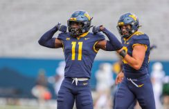 Oct 3, 2020; Morgantown, West Virginia, USA; West Virginia Mountaineers cornerback Nicktroy Fortune (11) celebrates after a missed Baylor Bears field goal during the first quarter at Mountaineer Field at Milan Puskar Stadium. Mandatory Credit: Ben Queen-USA TODAY Sports