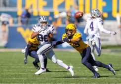 Oct 31, 2020; Morgantown, West Virginia, USA; Kansas State Wildcats wide receiver Phillip Brooks (88) catches a pass while defended by West Virginia Mountaineers safety Sean Mahone (29) during the second quarter at Mountaineer Field at Milan Puskar Stadium. Mandatory Credit: Ben Queen-USA TODAY Sports