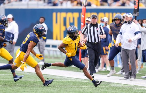 April 24, 2021; Morgantown, West Virginia, USA; West Virginia Mountaineers wide receiver Winston Wright (1) runs after a catch during the Spring Game at Mountaineer Field at Milan Puskar Stadium. Mandatory Credit: Ben Queen
