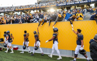 Nov 14, 2020; Morgantown, West Virginia, USA; West Virginia Mountaineers players celebrate with fans after defeating the TCU Horned Frogs at Mountaineer Field at Milan Puskar Stadium. Mandatory Credit: Ben Queen-USA TODAY Sports