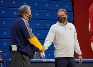 Dec 22, 2020; Lawrence, Kansas, USA; West Virginia Mountaineers head coach Bob Huggins shakes hands with Kansas Jayhawks head coach Bill Self before the game at Allen Fieldhouse. Mandatory Credit: Denny Medley-USA TODAY Sports