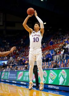 Dec 22, 2020; Lawrence, Kansas, USA; Kansas Jayhawks forward Jalen Wilson (10) shots three point basket during the first half against the West Virginia Mountaineers at Allen Fieldhouse. Mandatory Credit: Denny Medley-USA TODAY Sports