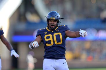 MORGANTOWN, WV - NOVEMBER 14: West Virginia Mountaineers defensive lineman Akheem Mesidor (90) celebrates after making a sack during the fourth quarter of the college football game between the TCU Horned Frogs and the West Virginia Mountaineers on November 14, 2020, at Mountaineer Field at Milan Puskar Stadium in Morgantown, WV. (Photo by Frank Jansky/Icon Sportswire)