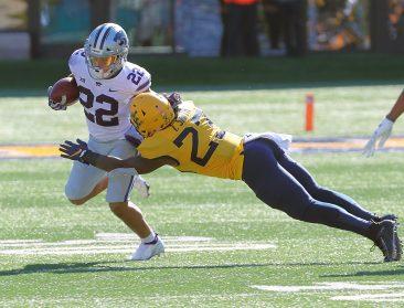 WVU's Tykee Smith tackles Kansas State's Deuce Vaughn.
