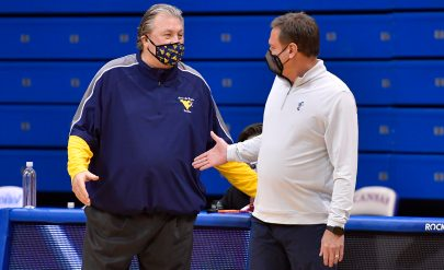 Kansas coach Bill Self, right, welcomes West Virginia coach Bob Huggins to Allen Fieldhouse before the teams slugged in out Tuesday night in Lawrence.