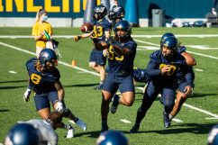 Linebackers practice a drill during a WVU Football practice on March 27, 2021 in Milan Puskar Stadium. (Duncan Slade/WVSportsNow)